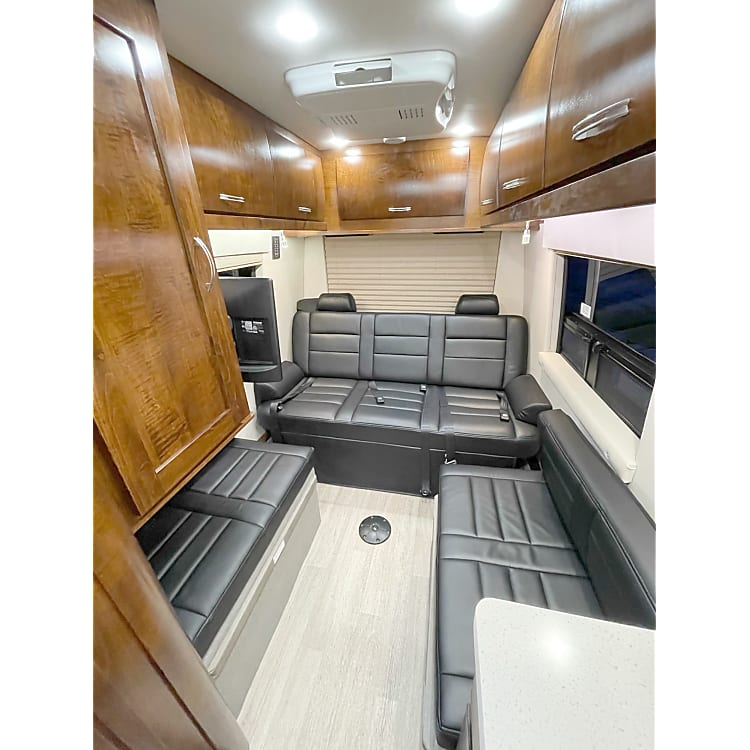 Rear bench seat and side jump seat.