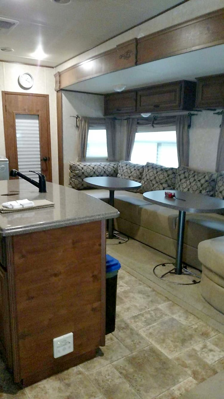 Huge Dinning area, two tables for great family time, Large TV, Island and overhead storage for food and necessities to make the trip a memorable one. Tables remove for a inflatable Queen size bed to make it sleep 8 if needed. Two recliners are there also for plenty of laid back time...
