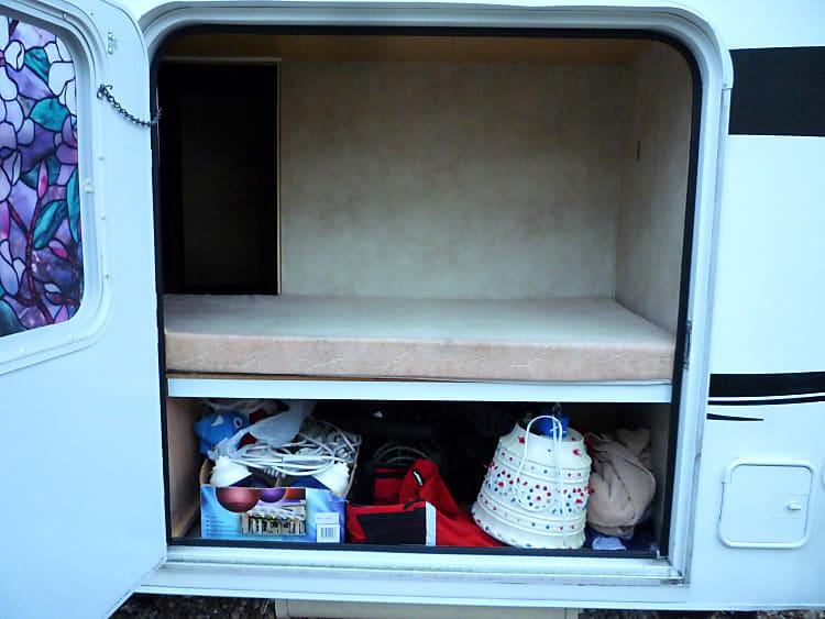 Side acess door to bunk bed area.  Additional storage below