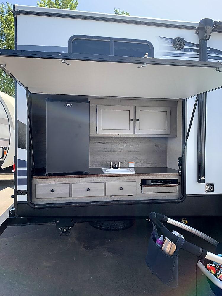 Outside Kitchen, fridge, sink and 2 burner stove, TV hook ups