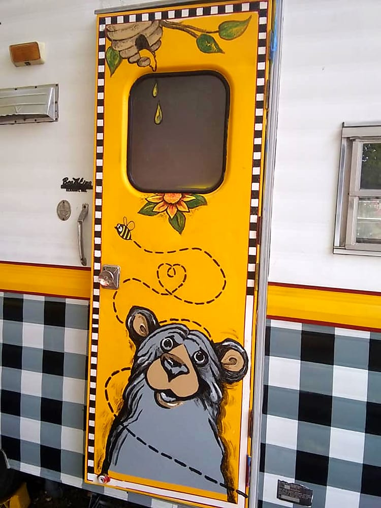 The Bee and Bear are complimentary design motifs carried throughout the camper, both inside and out.