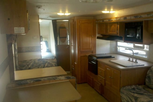 Kitchen area is large and comes with a coffee maker, toaster, microwave, gas stove, cutting board and all utensils needed.
