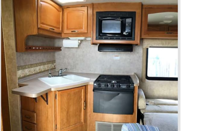 The kitchen offers everything you'll need, including microwave, 3 gas range to burners and an oven.