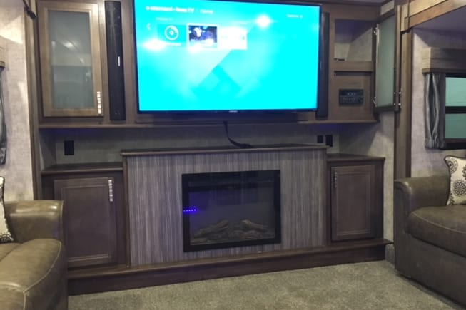 Entertainmaent  center including flat-screen TV, fireplace, CD/DVD player and leather recliners!