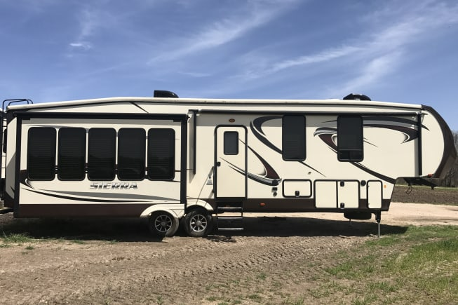 Front side of rv where the door and awning are located