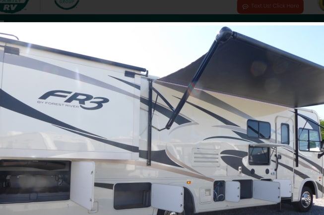 FR3 exterior with view of awning and tv.