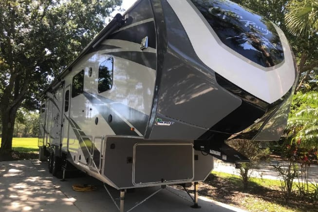 This is a 2019 open range 5th. Sleeps up to eight people. Has bath and half. Outdoor kitchen. Clean and Covid-19 ready. It is a home away from home