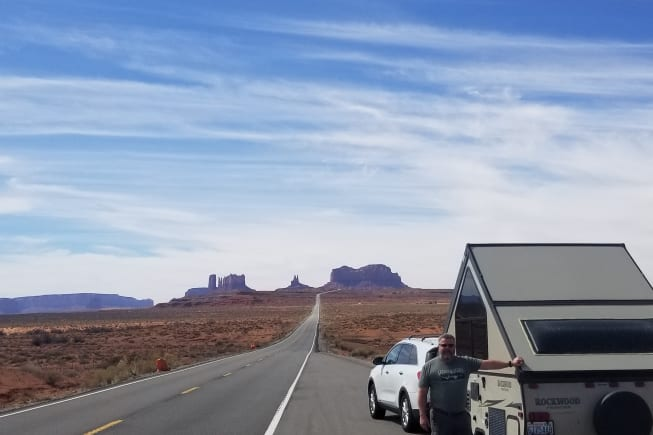 On the road in Monument Valley. Quick stop to pop up for a photo op.
