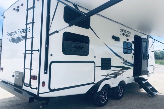 Brand new, manufactured in May 2019. Show-stopping 20ft motorized awning with LED lights.