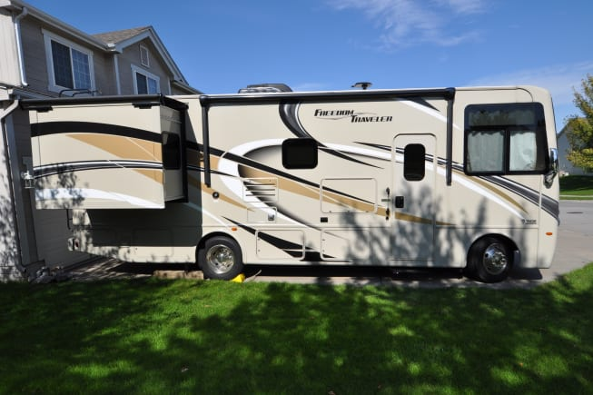 Slide out bedroom for extra space. Lots of under coach storage with auto awning and outside tv and blue tooth sound system.