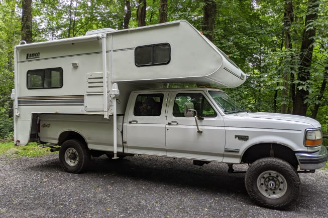 This truck-bed camper set-up (Lance and F-350 diesel truck) makes camping cozy and full of adventure!