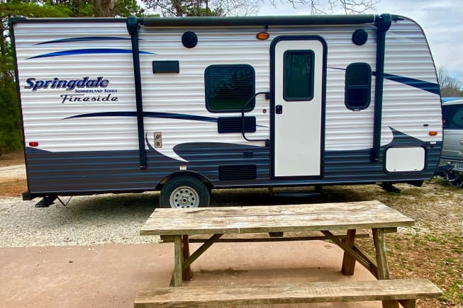entry side is camper with hand-rail and step.
