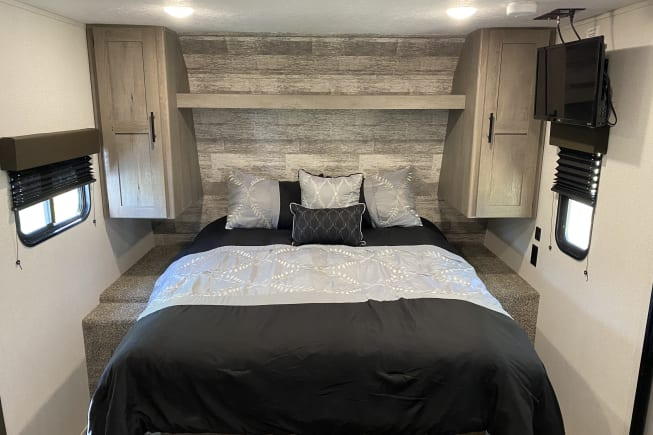 front Queen Bed with walk around sides. Clothes Closets and shelve. USB port on the right side.