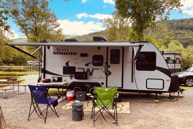 We supply you with 2 camp chairs, a folding table, outdoor rug, grill with one propane tank and an outdoor TV