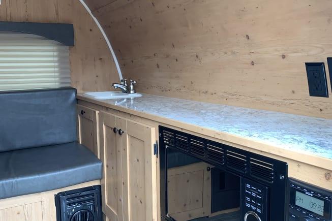 Microwave, radio, interior sink,