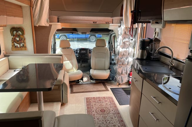 Driver/passenger chairs rotate to living room