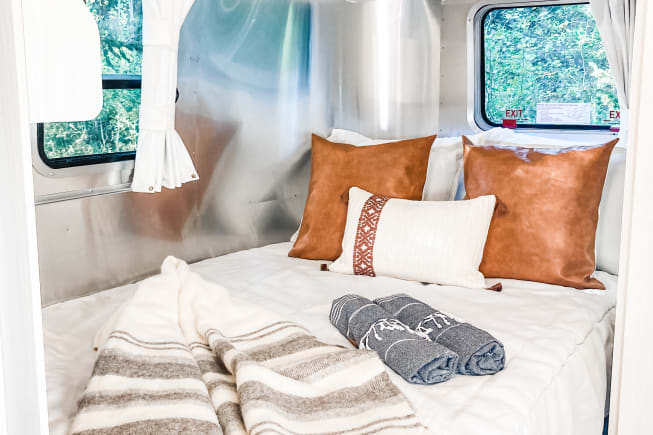 Luxury linens with wool blanket and fresh white sheets.