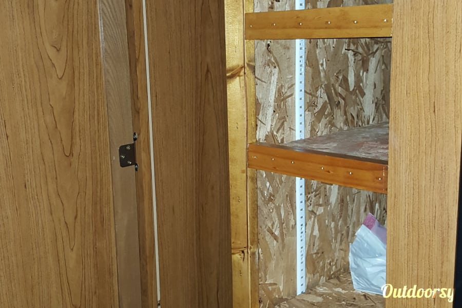 1994 Coachmen Catalina Zelienople, PA Closet storage with modified shelving for kitchen use.