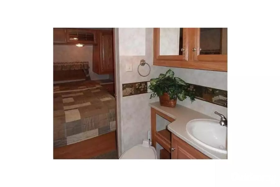 2 Bedroom 1.5 Bath 30ft Dual Slide Out Ready To Camp Westland, MI Master bath sink with a view of the bedroom.  Master bathroom has it's own toilet, sink and medicine cabinet.