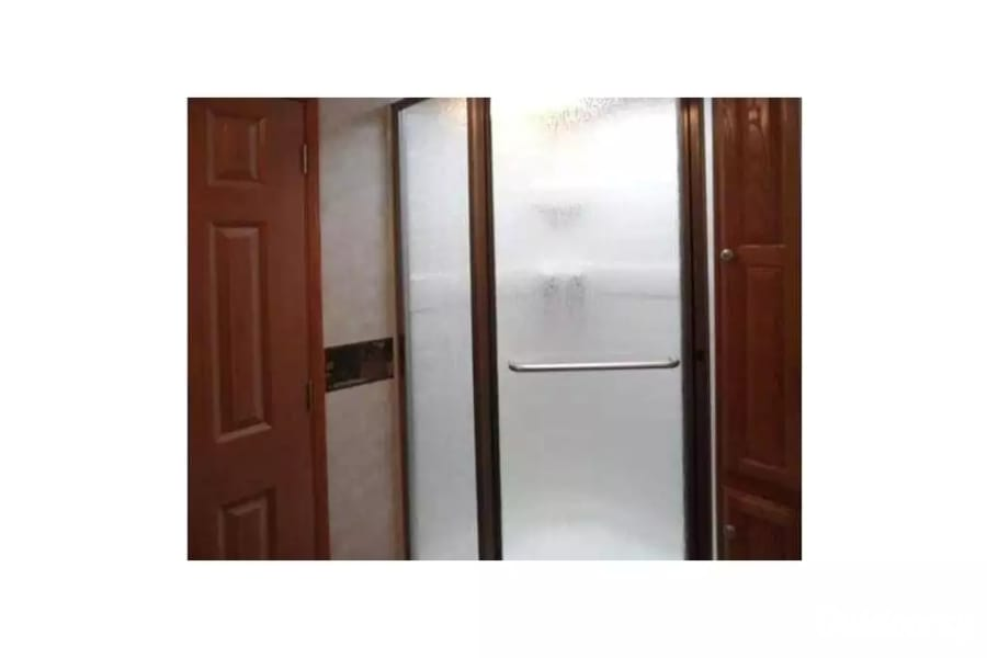 2009 Palomino Sabre Livonia, Michigan Shower in master bathroom with tall bathroom pantry not pictured but the to right of the shower.  Lots of storage.