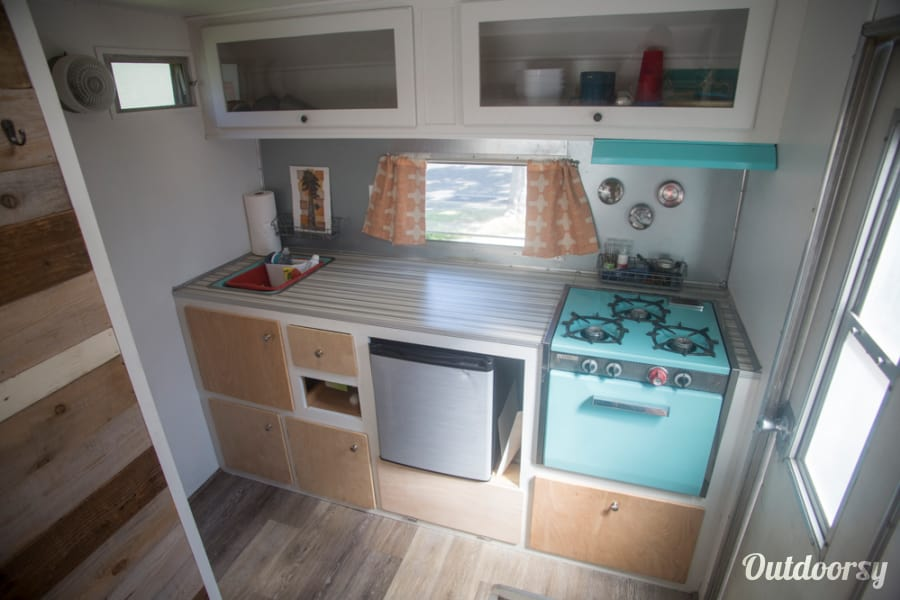 1964 Vintage Nomad Trailer Los Angeles, CA Kitchen.  Three burner stove, shore power fridge, plenty of space for food and supplies.  Comes with plates, cutlery, cups, pots and pans, basic cooking utensils.