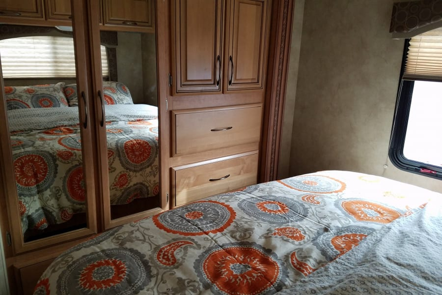 Main Bedroom with queen size bed. Can be closed off with lots of storage