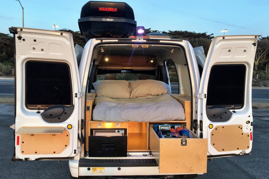 Comfy bed, great storage, full camping kitchen, oh my!