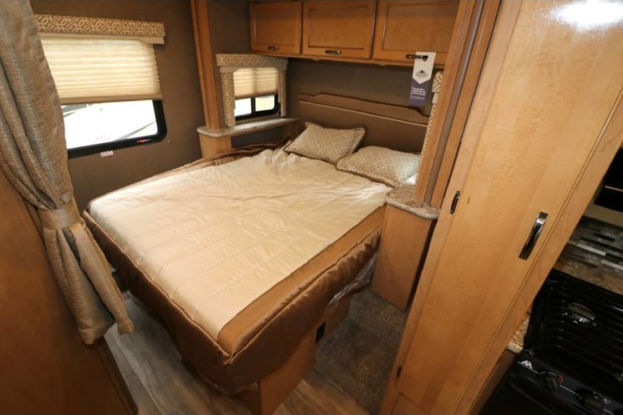 Queen size bed in slide out for greater space.