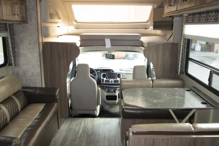 Interior with cab-over bunk.  Seating for 8, all with seatbelts!