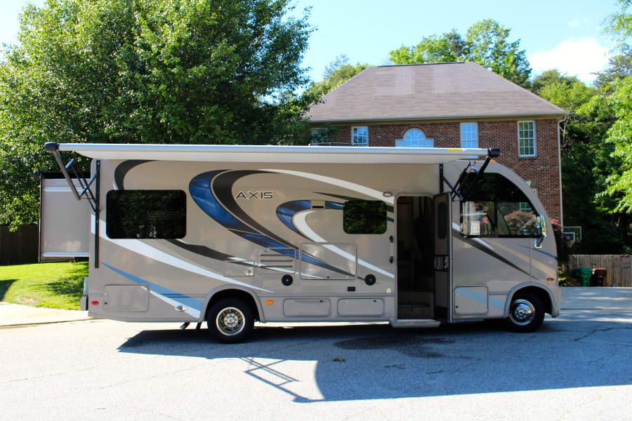 The exterior of the coach with the awning extended.