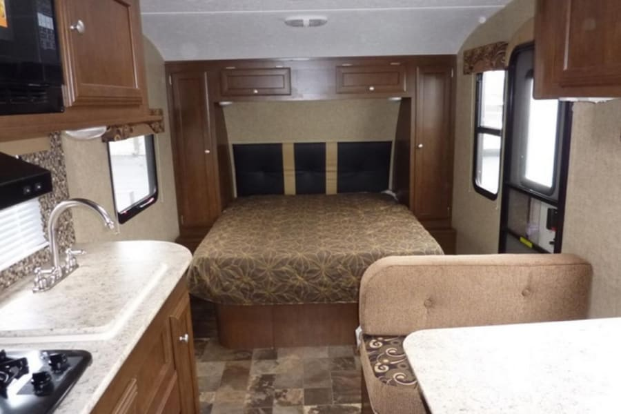 """Standards Bedroom • Innerspring Mattress • Extra foam mattress • Pleated Night Shades • Overhead Storage • Under the Bed Storage • LED Lights • 13.5K AC • (2) Interior Speakers • 82"""" Interior Height  Please no smoking or vaping in the RV! Additional fees will be added."""