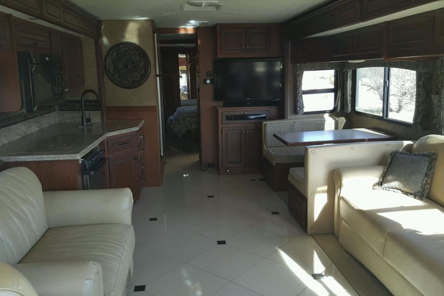 This is the main room where you and your family can 'hang- out'. This is the room when slide-outs are deployed. This photo was taken March 2016 standing beside the drivers seat. The Sofa and Loveseat have since been covered with an animal-friendly furniture covers.