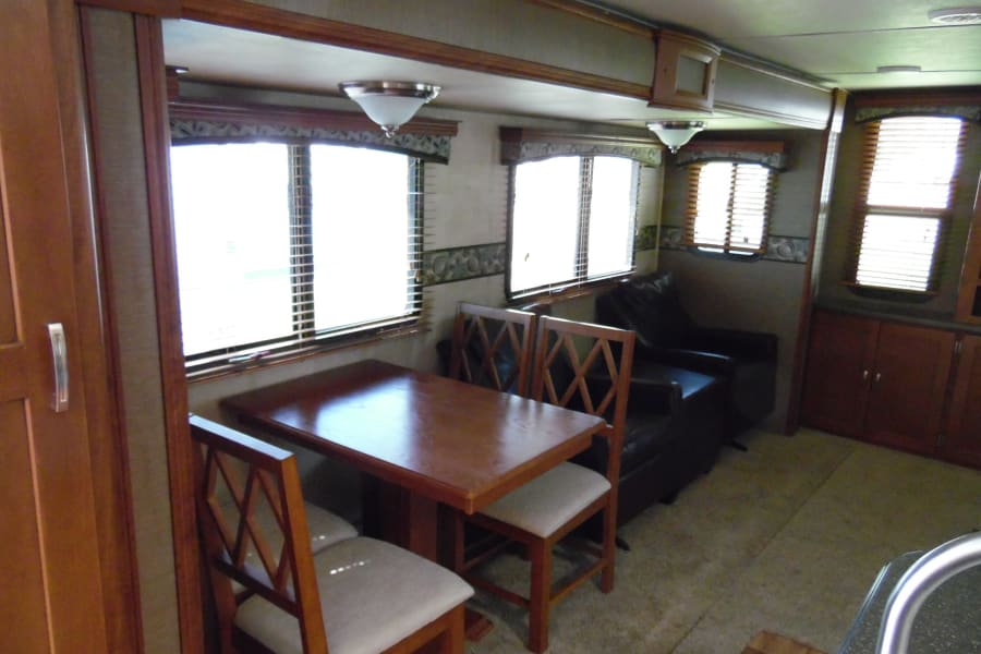 Seperate dining table with 4 chairs as well as 2 swivel rocking chairs.