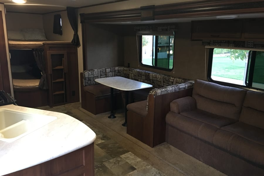 The large slide out gives ample room for the living and dinning area.  And you can all see there is plenty of room in the Double Double Bunks!
