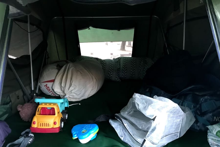 "The tent includes a 94"" x 55"" x 2"" thick mattress, small storage pockets sewn to the walls and places to hang gear."