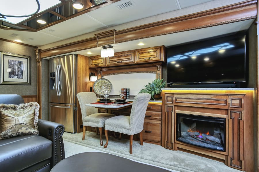 dining for two or four, extra chairs under king masterbed.  Bose sound bar, fireplace with heat. Heated floors, Aqua Hot instant heat, electric or diesel heater for long hot showers and toasty floors