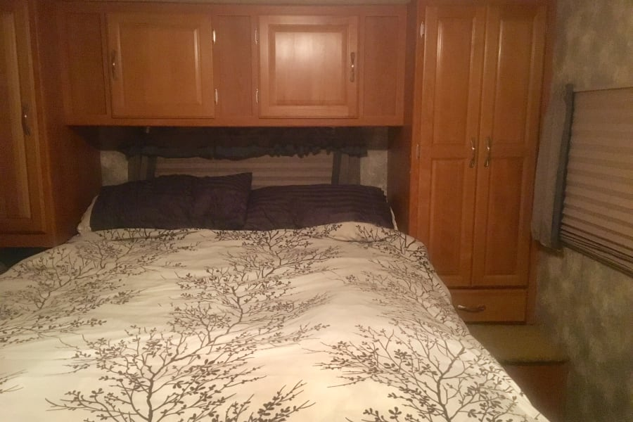 Large master bedroom with comfortable firm queen mattress, linens and towels for 6. Storage closet for hanging clothes.