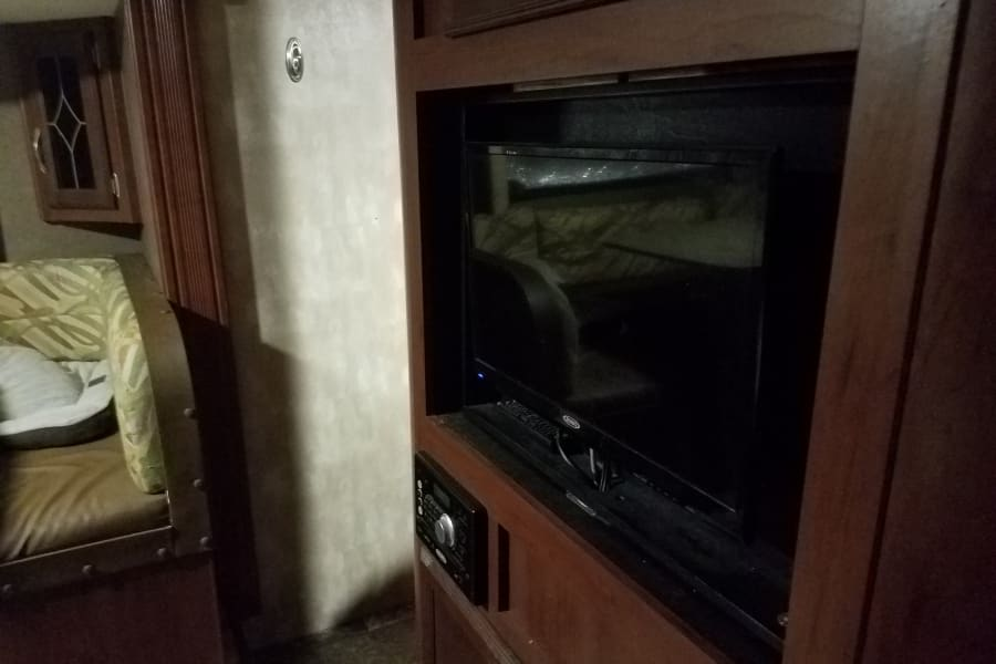 entertainment system rotates to bedroom or living area