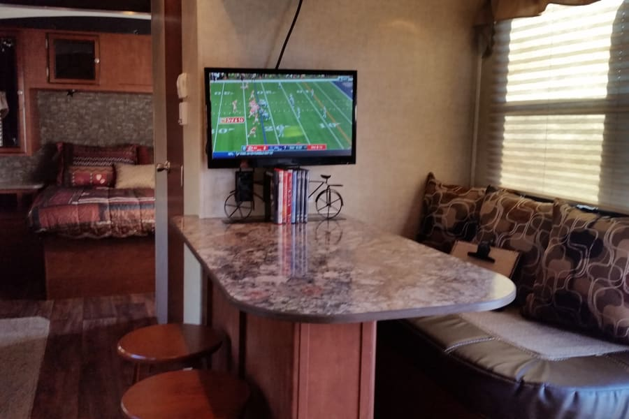 Just because you are camping doesn't mean you have to miss the big game.  The trailer comes equipped with an omni-directional antenna that can pick up HD over-the-air TV signals.  We also have hook-ups for cable and/or satellite