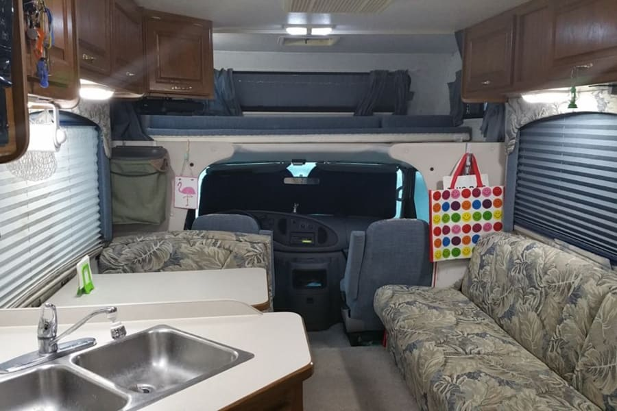 Living area and bed over cab up to 300 pounds