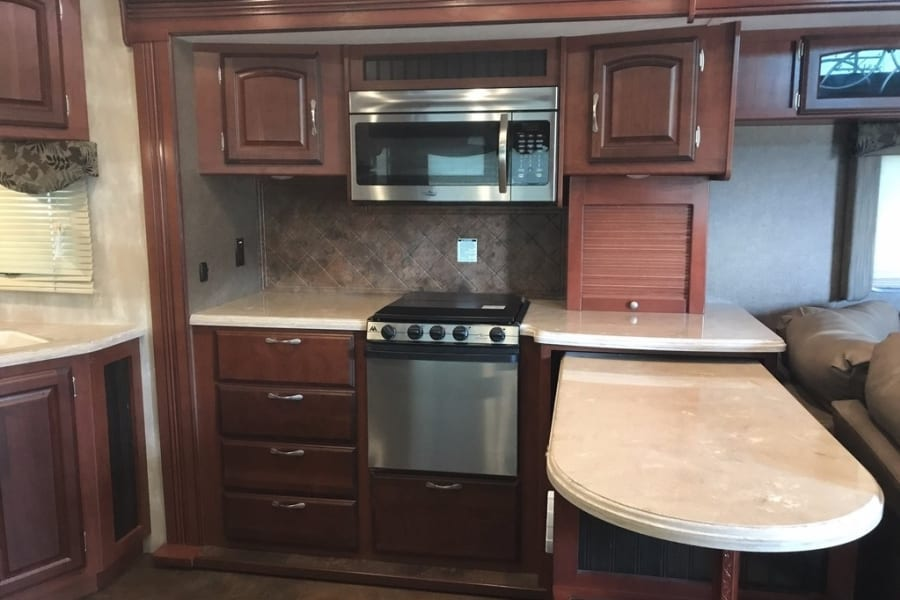Large kitchen with side by side refrigerator and nice island.