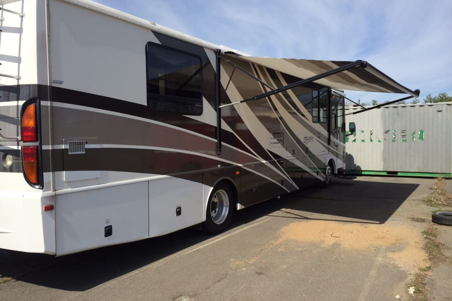 Awning extended and under coach storage