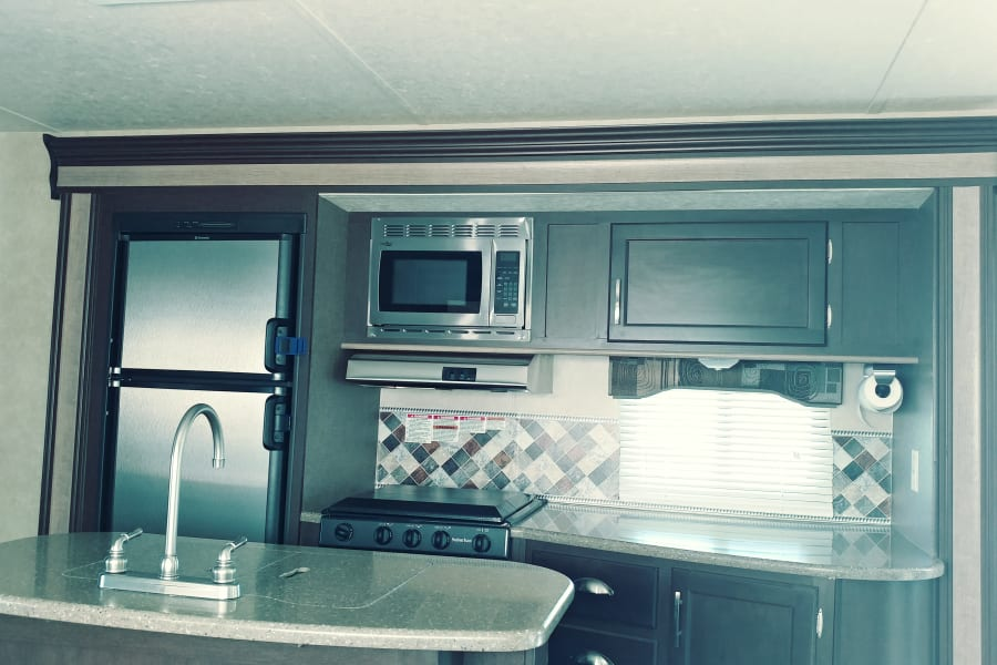 Kitchen. Includes pots, pans, coffee maker, utincils. Also the rest of the usual kitchen stuff