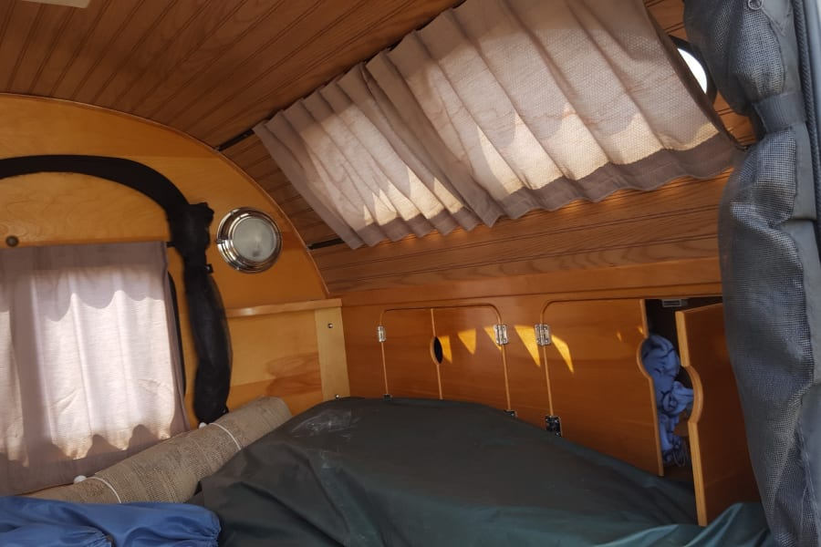 Simple pic of the storage at the head of the bed