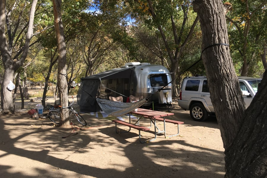 Camper set up with awning and screen room