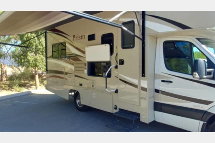 Outside of RV with TV DVD player stereo.