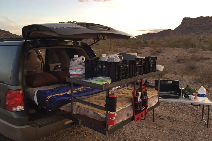 You can see how the bed and rack slides out the back, giving you access to the under-bed storage, and allowing you to sleep under the stars, if the weather is nice, or slide it in and sleep inside!