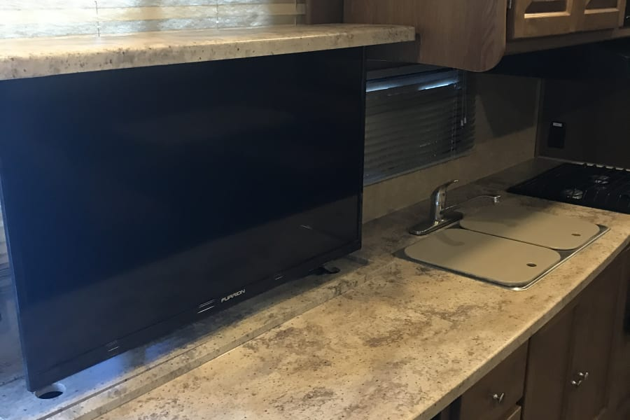 Tv slides out of counter top