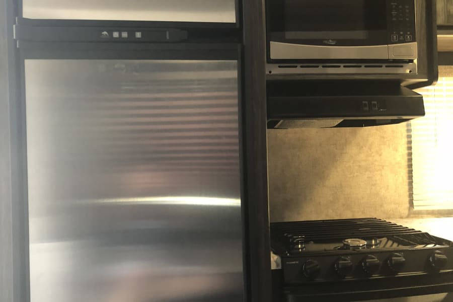 Large fridge and freezer. ( Small outside beer fridge also)