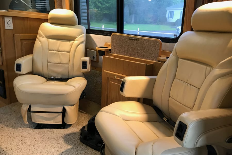 Dual fully adjustable captains chairs for passengers.